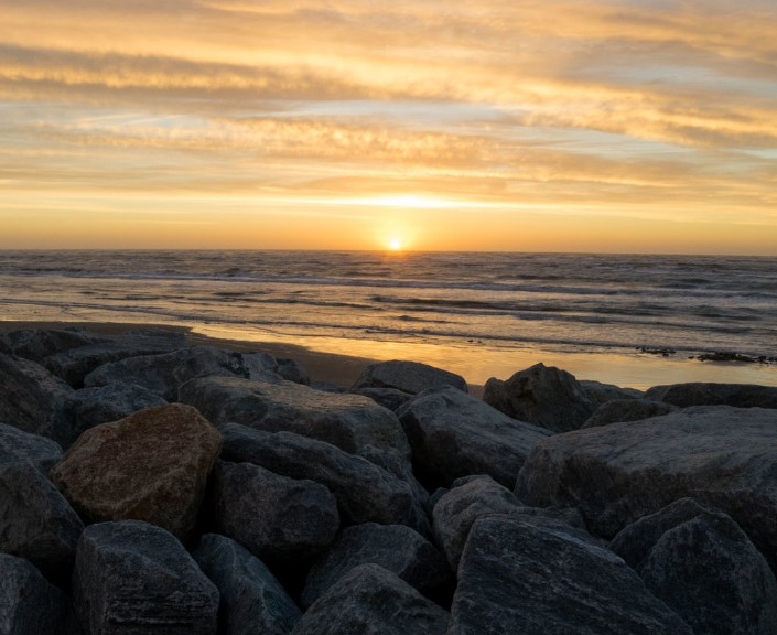 Caption: The sea wall, just like the coast, is gradually wearing away., Credit: Nick Mott