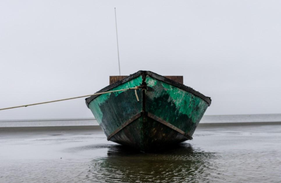 Caption: A boat floats off the coast of Shishmaref, Credit: Nick Mott