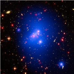 Caption: Galaxy cluster IDCS J1426 is located 10 billion light-years from Earth and weighs almost 500 trillion suns., Credit: ESA/Hubble