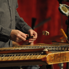 Caption: Ted Yoder's hammered dulcimer on the WoodSongs Stage.