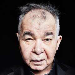 Caption: John Prine