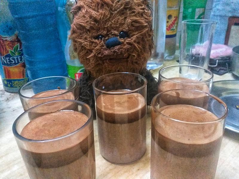 Caption: Chewie makes Dalonga coffee, Credit: Sandip Roy