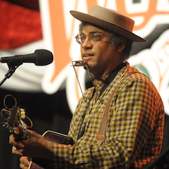 "Caption: ""The American Songster"" Dom Flemons on the WoodSongs Stage."