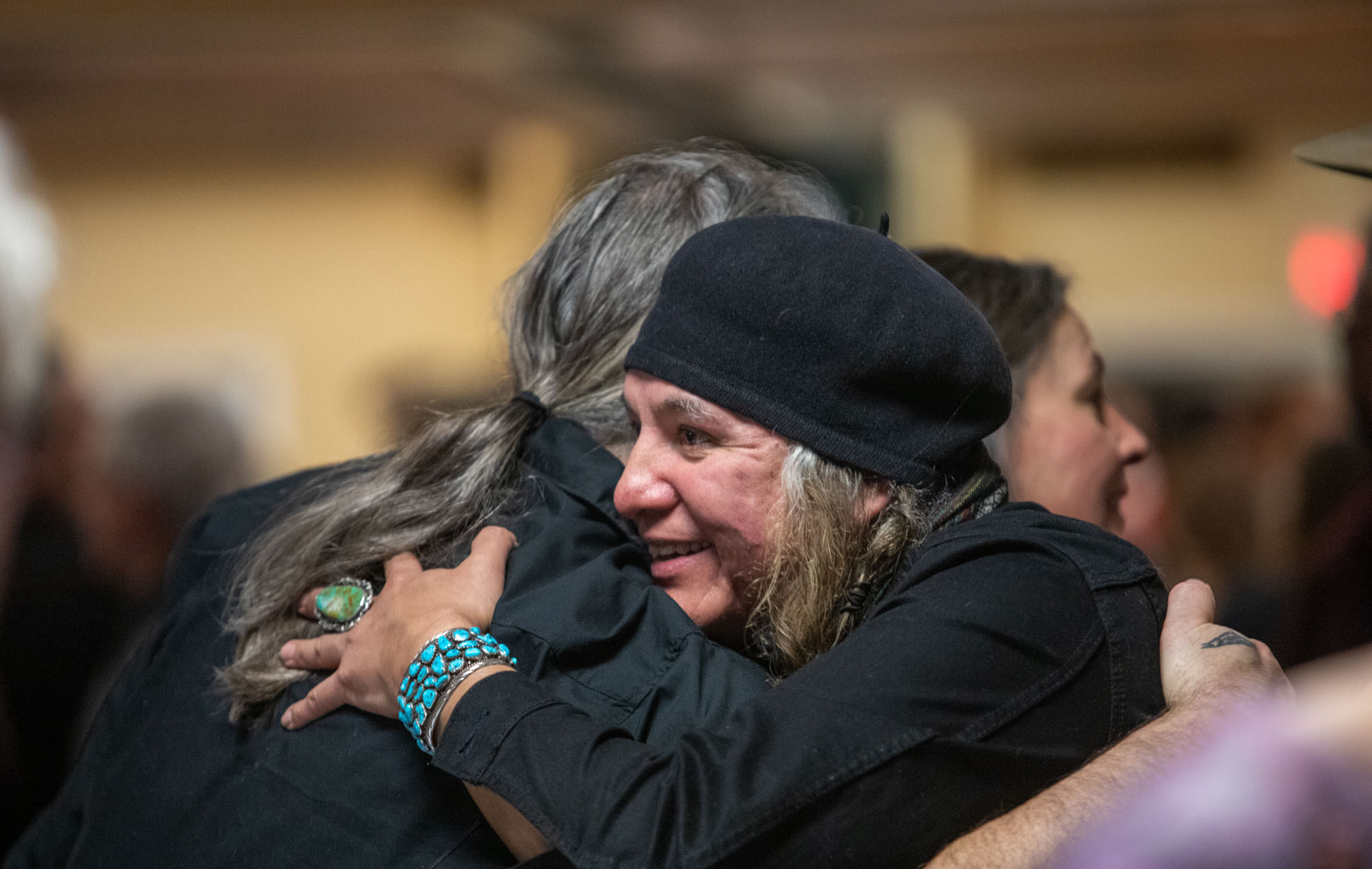 Caption: Embracing at the celebration of recognition in Great Falls, Montana, Credit: Allison Berrian