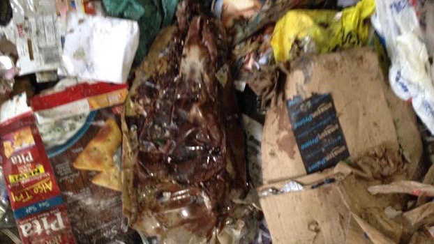 Caption: Recycling contaminated by food and liquid spills. , Credit: Photo from RI Resource Recovery.
