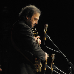 Caption: Folksinger Michael Johnathon on the WoodSongs Stage.