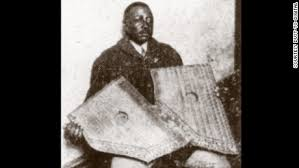 Caption: Washington Phillips with his homemade instrument