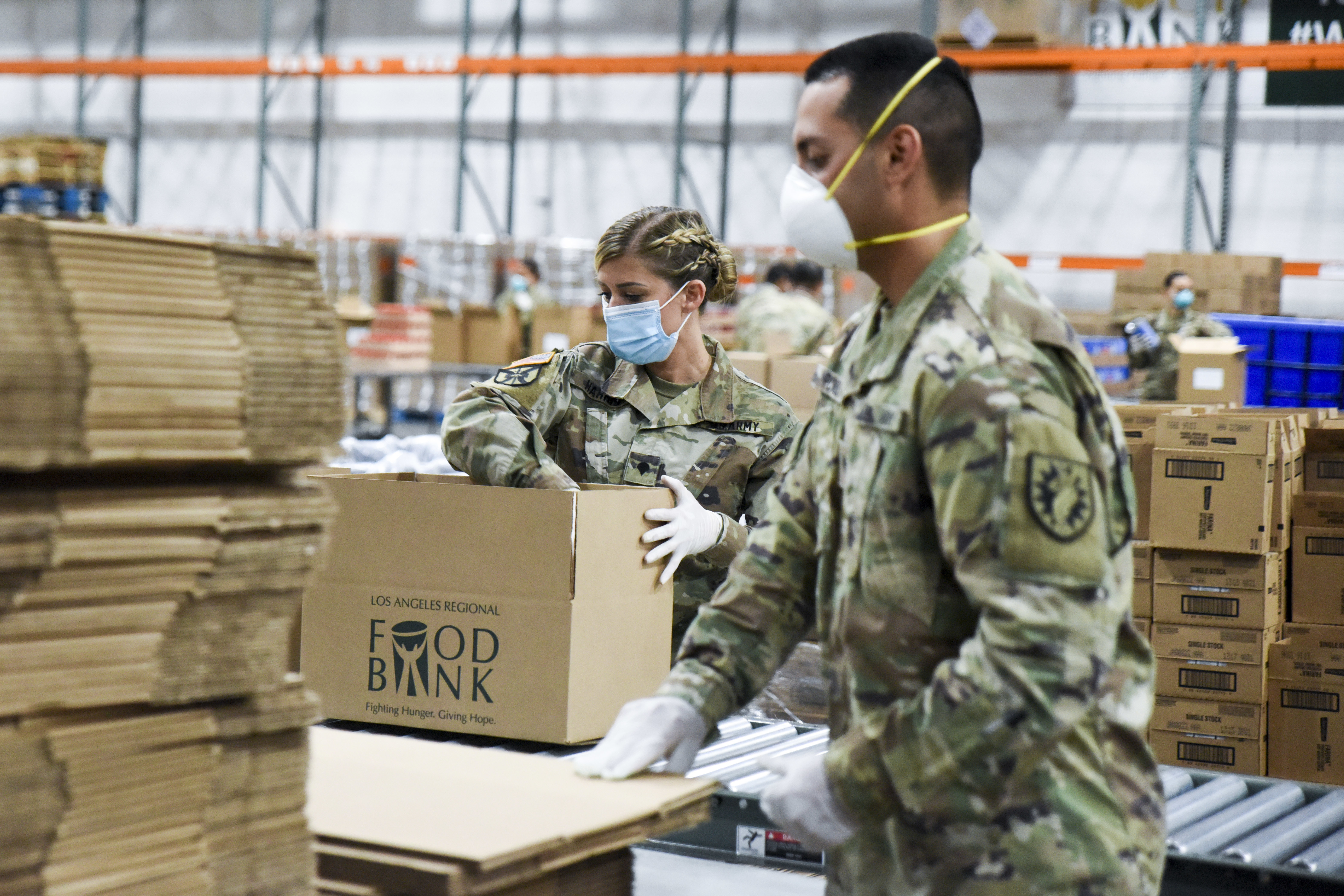 Caption: Members of the California Army National Guard assemble emergency food kits at the Los Angeles Regional Food Bank. , Credit: Jason Sanchez / U.S. Air National Guard