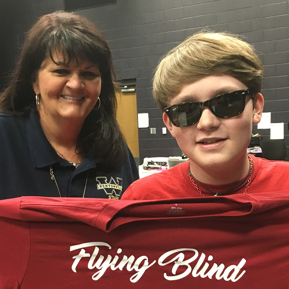 Caption: Rugenia Keefe, left, a paraprofessional who assisted Cole Phillips for most of high school after he lost his sight, spoke with the graduating senior for a remote conversation from Bentonville, Ark., Credit: Cole Phillips
