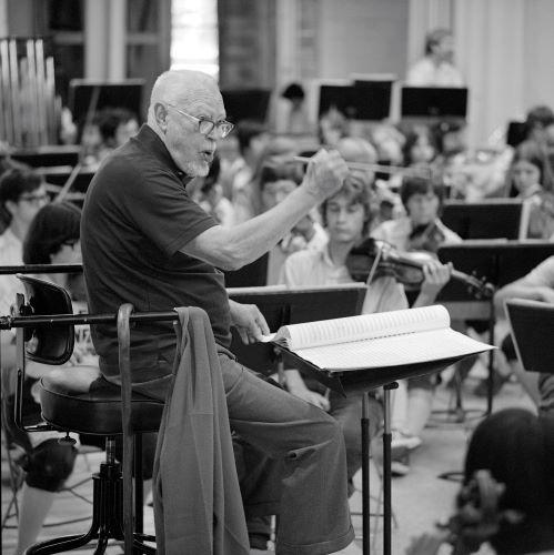 Caption: Howard Hanson rehearses with the World Youth Symphony Orchestra, 1977