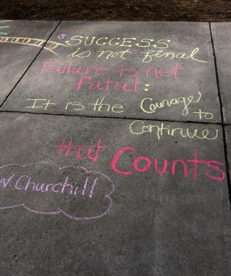 Caption: Sidewalk chalk messages this spring at Fond du Lac Tribal and Community College, Credit: Fond du Lac Tribal and Community College/Facebook