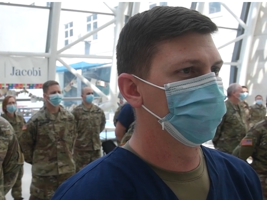 Caption: Service members receive thanks from the hospital staff at Jacobi Medical Center in New York, where they helped treat COVID-19 patients., Credit:  Xavier Navarro / U.S. Air Force