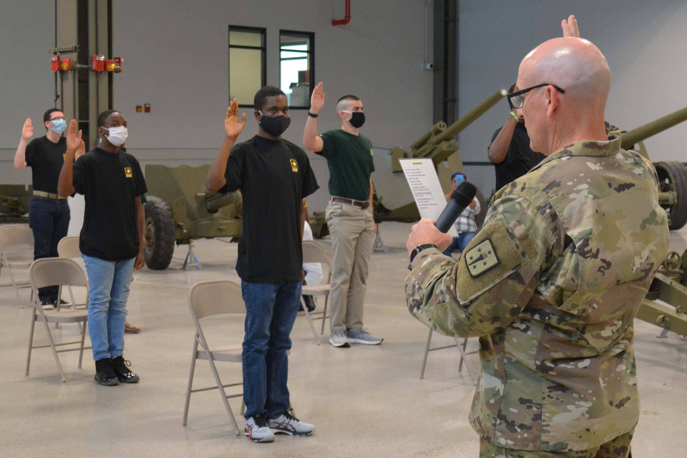Caption: Army recruits take their Oaths of Enlistment at Fort Lee, Va. June 22., Credit:  Patrick Buffett / U.S. Army