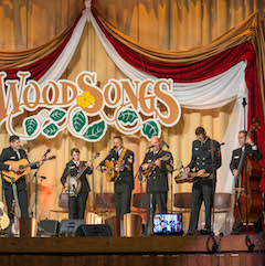 Caption: THE US Navy band Country Current on the WoodSongs Stage.