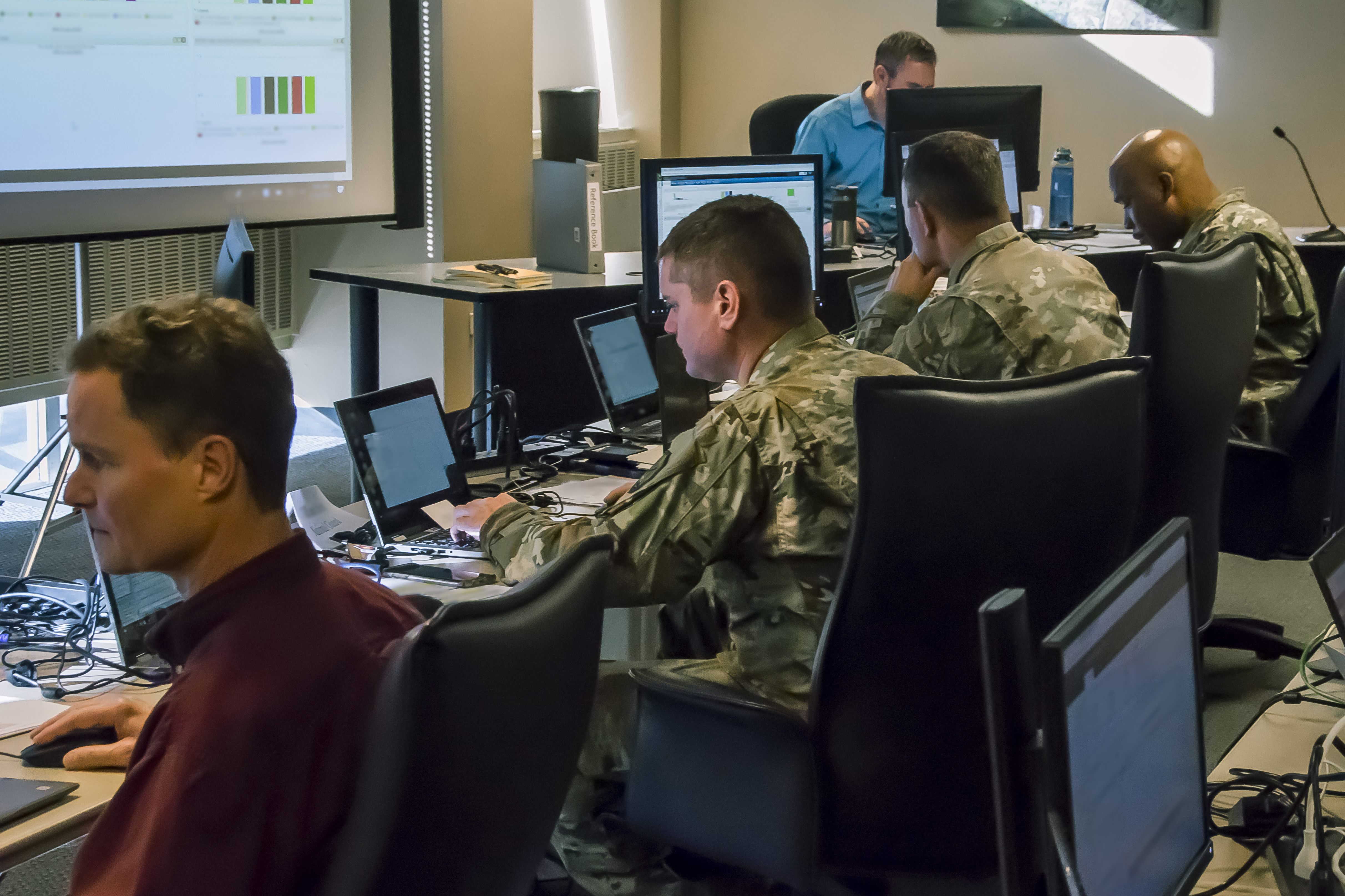 Caption: Members of the Colorado National Guard help monitor network traffic and advise the Secretary of State's office during the Nov. 2018 election. The Guard is once again helping protect elections against cyberattack in 2020., Credit:  Darin Overstreet / Colorado National Guard