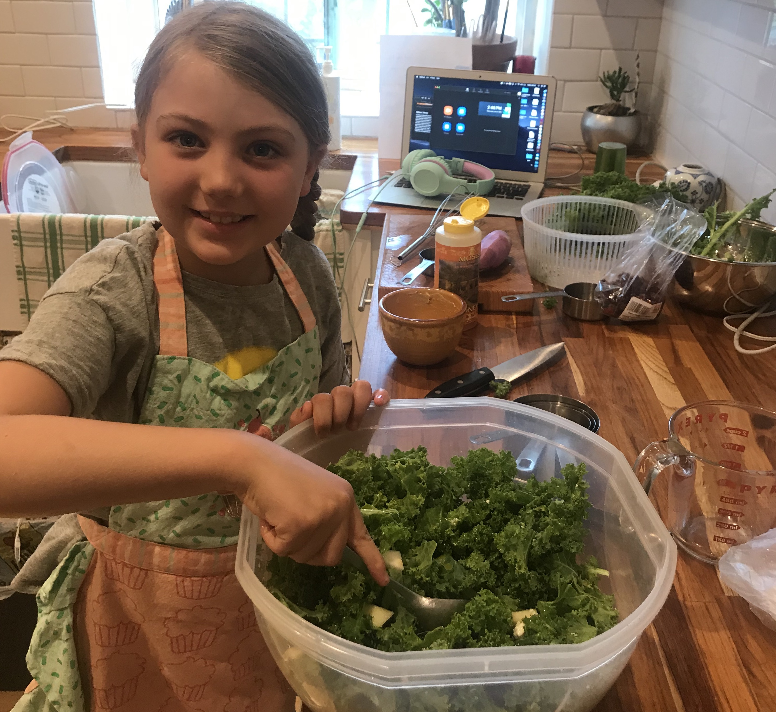 Caption: Maya makes the kale salad during our recording session, Credit: Michelle Myers