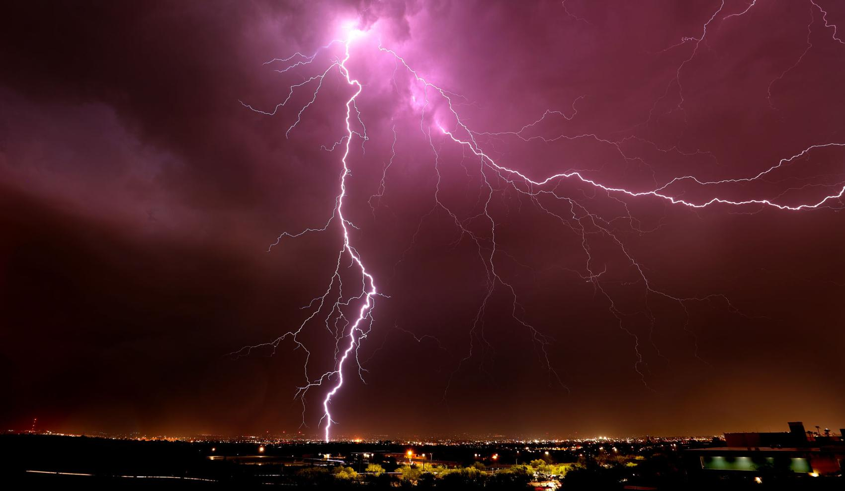 Caption: A lightning bolt strikes in the western part of the city, part of the second of two bands of monsoon storms to roll over the area, Tucson, Ariz., August 28, 2019., Credit: Kelly Presnell / Arizona Daily Star