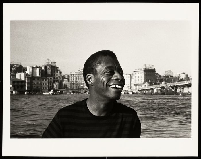 Caption: James Baldwin on the water of the Golden Horn, Istanbul © Sedat Pakay 1965. , Credit: Collection of the Smithsonian National Museum of African American History and Culture.