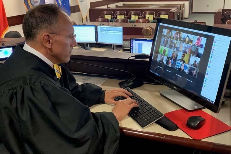 Caption: Hillsborough, Fla. County Circuit Judge Michael Scionti presides over a virtual Veterans Treatment Court session on Zoom., Credit: Thirteenth Judicial Circuit of Florida