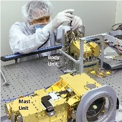 Caption: The two parts of the SuperCam instrument are shown mounted on an optical bench. The units are connected by electronic cables and an optical fiber., Credit: Los Alamos National Lab
