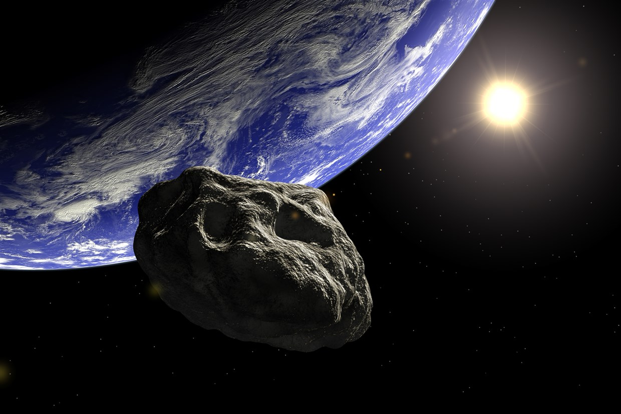 Caption: Artistic illustration of an asteroid approaching Earth. , Credit: Image Credit: Dieter Spannknebel / Getty Images