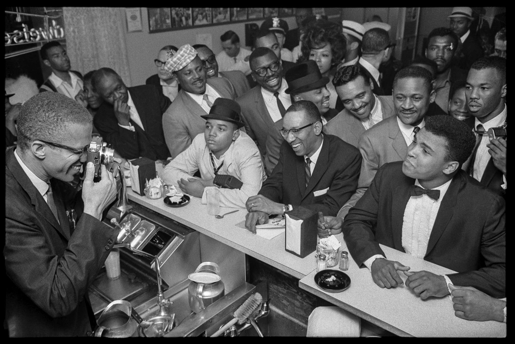 Caption: Malcolm X photographs Muhammad Ali after his victory over Sonny Liston in 1964. (Photo: Bob Gomel/CC)
