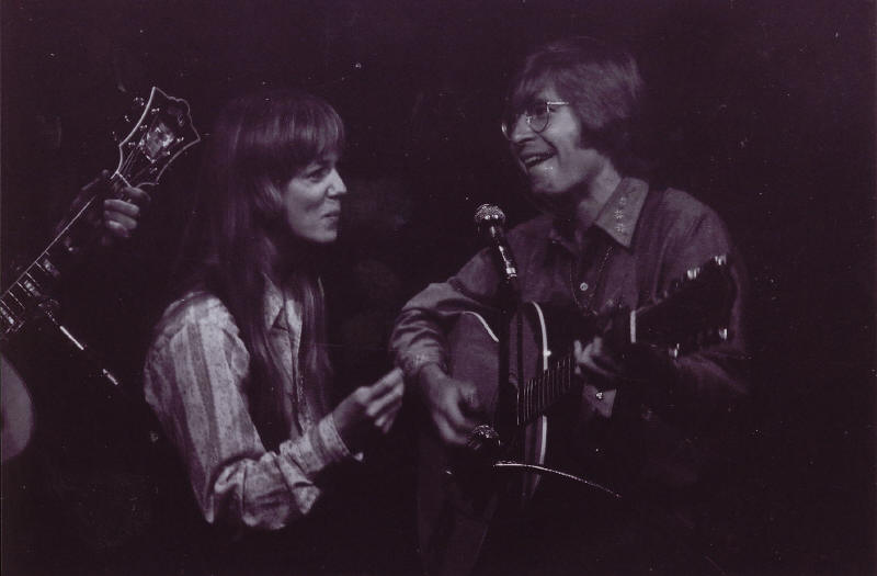 """Caption: Taffy Nivert and John Denver playing """"Country Roads"""" at the Cellar Door in December 1970, one of the first times the song was performed in public. Bill Danoff's guitar is to the left. , Credit:  Courtesy Bill Danoff"""