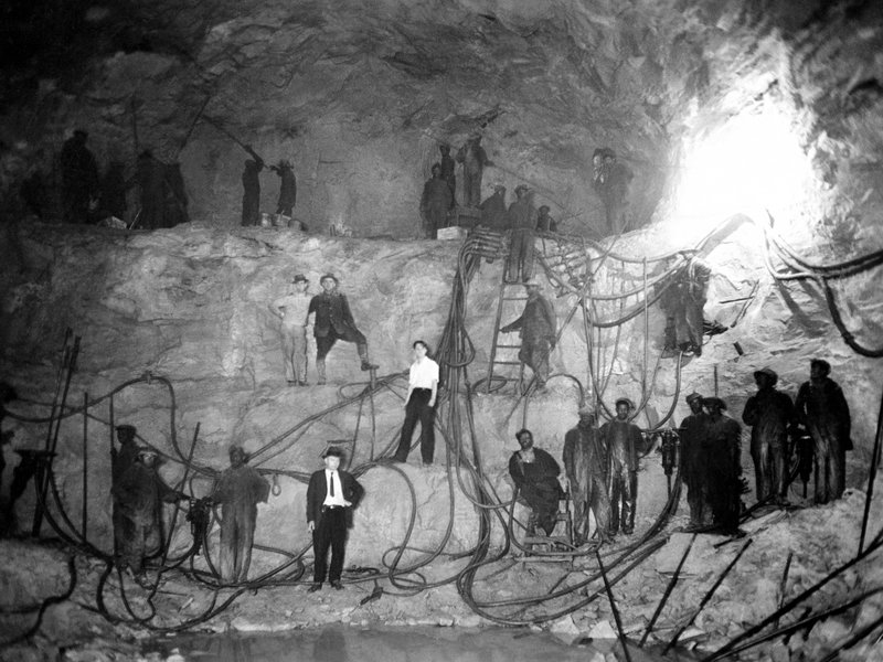Caption: A drilling crew poses for the above photo in 1931 (without respirators) in the Hawks Nest Tunnel. Courtesy of Elkem Metals Collection, West Virginia State Archives.