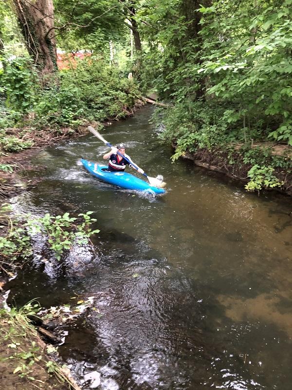 Caption: Mitch Treadwell paddling Kid's Creek in Traverse City, Credit: Linnaea Melcarek