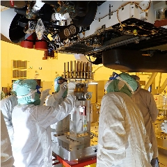 Caption: In this image taken on May 20, 2020 at the Kennedy Space Center, engineers and technicians insert 39 sample tubes into the belly of the Perseverance Mars rover. Each tube is sheathed in a gold-colored cylindrical enclosure to protect it from contamination, Credit: NASA/JPL-CALTECH