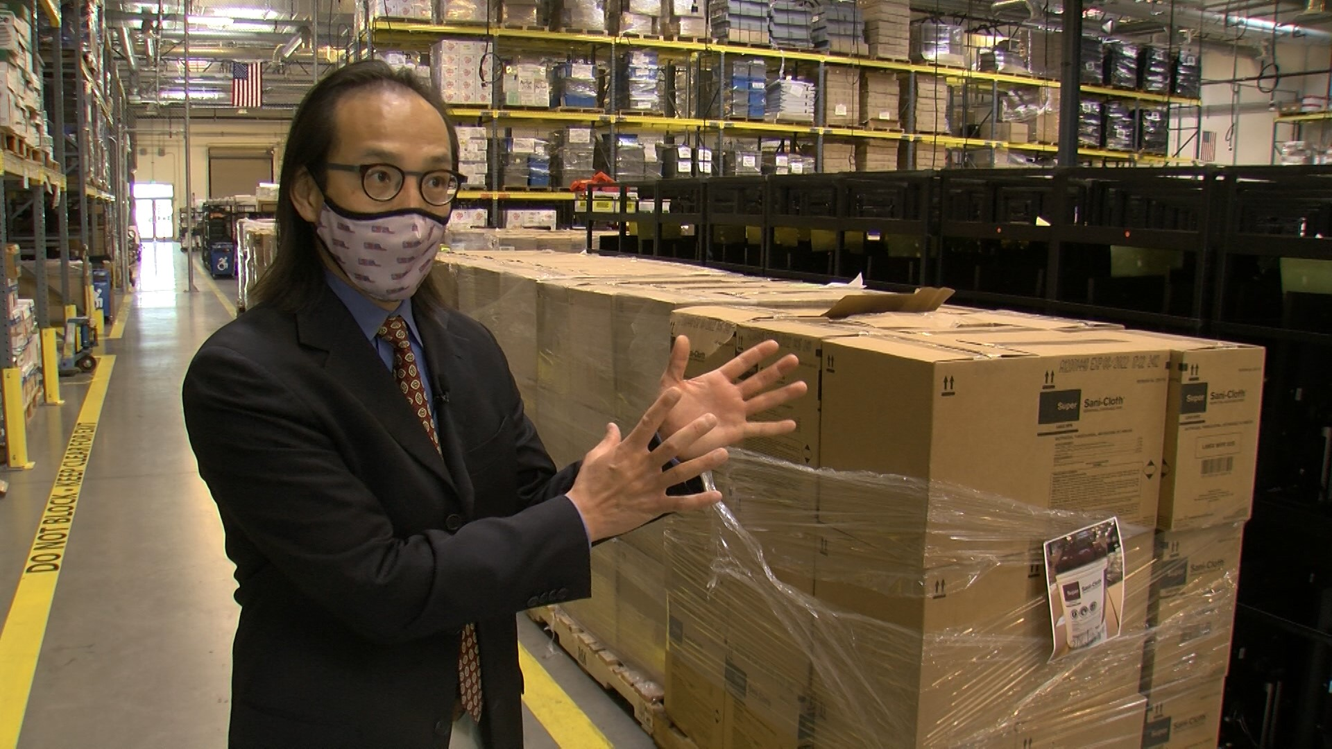 Caption: San Diego County Registrar of Voters Michael Vu stands in a warehouse filled with supplies for the 2020 election., Credit: Mike Damron / KPBS