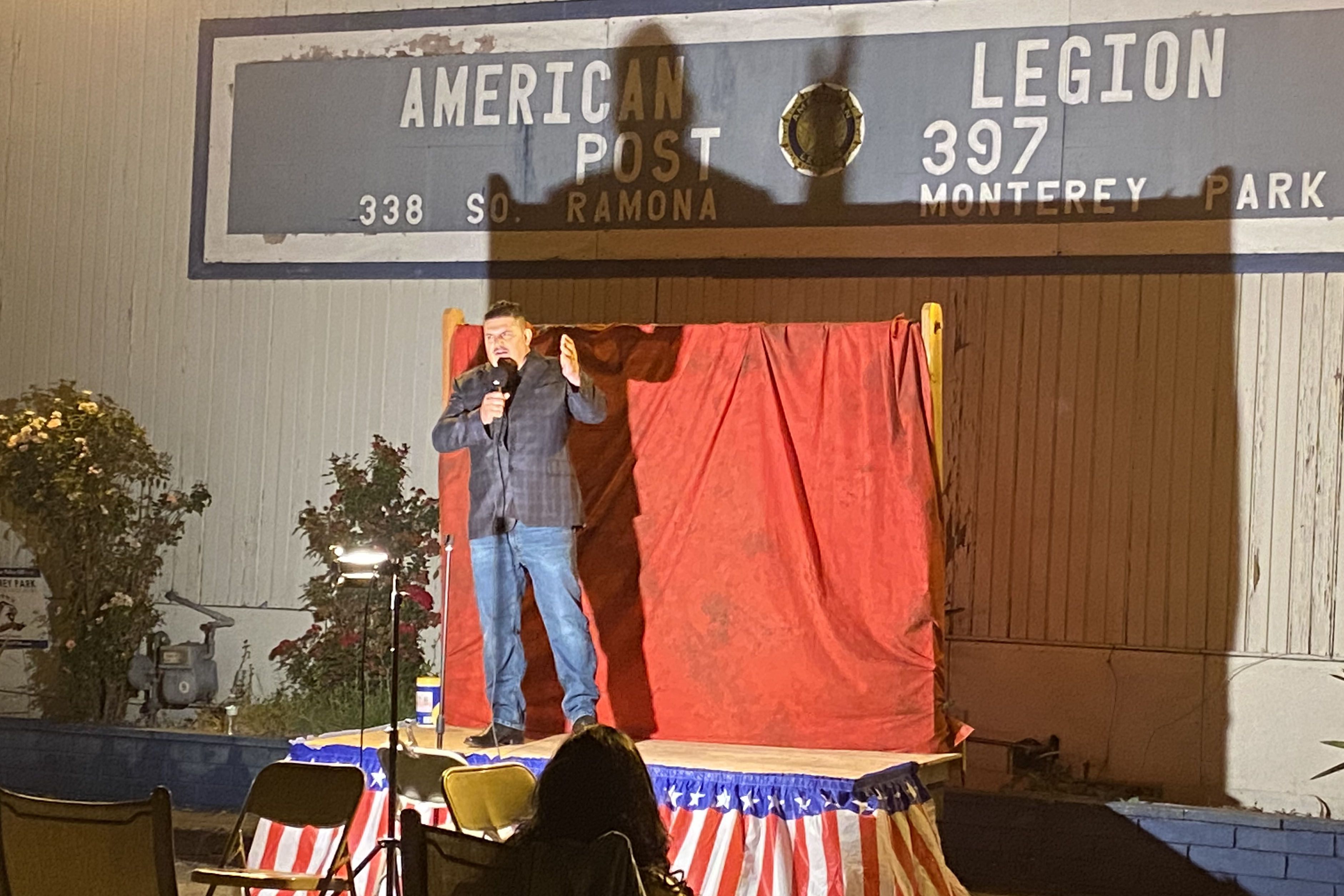 Caption: Comedian Fernando Sanchez warms up attendees of American Legion Post 397's comedy night Oct. 10. The Monterey Park, Cal. post has turned to events like this to raise money during the pandemic., Credit: Robert Garrova / American Homefront