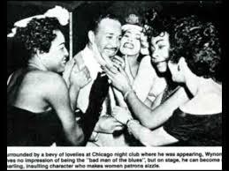 Caption: Wynonie Harris with fans