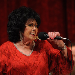 Caption:  Rock and Roll Hall of Fame inductee Wanda Jackson on the WoodSongs Stage.