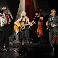 Caption: Emmylou Harris on the WoodSongs Stage.