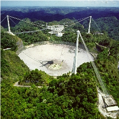 Caption: The great radio telescope at Arecibo in better days., Credit: NSF/UCF