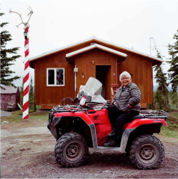 Caption: Gwich'in elder Sarah James in front of her old cabin in her hometown, Arctic Village, Alaska. , Credit: Brian Adams