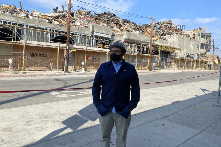 Caption: Manuel Bernal, president of East LA Community Corporation, stands in front of what remains of the Nuevo Amanecer complex, which had 30 units for homeless veterans., Credit: Robert Garrova / American Homefront