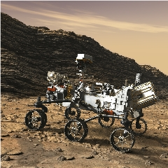 Caption: Artist concept of the Perseverance rover examining an outcrop on Mars., Credit: NASA/JPL-CALTECH