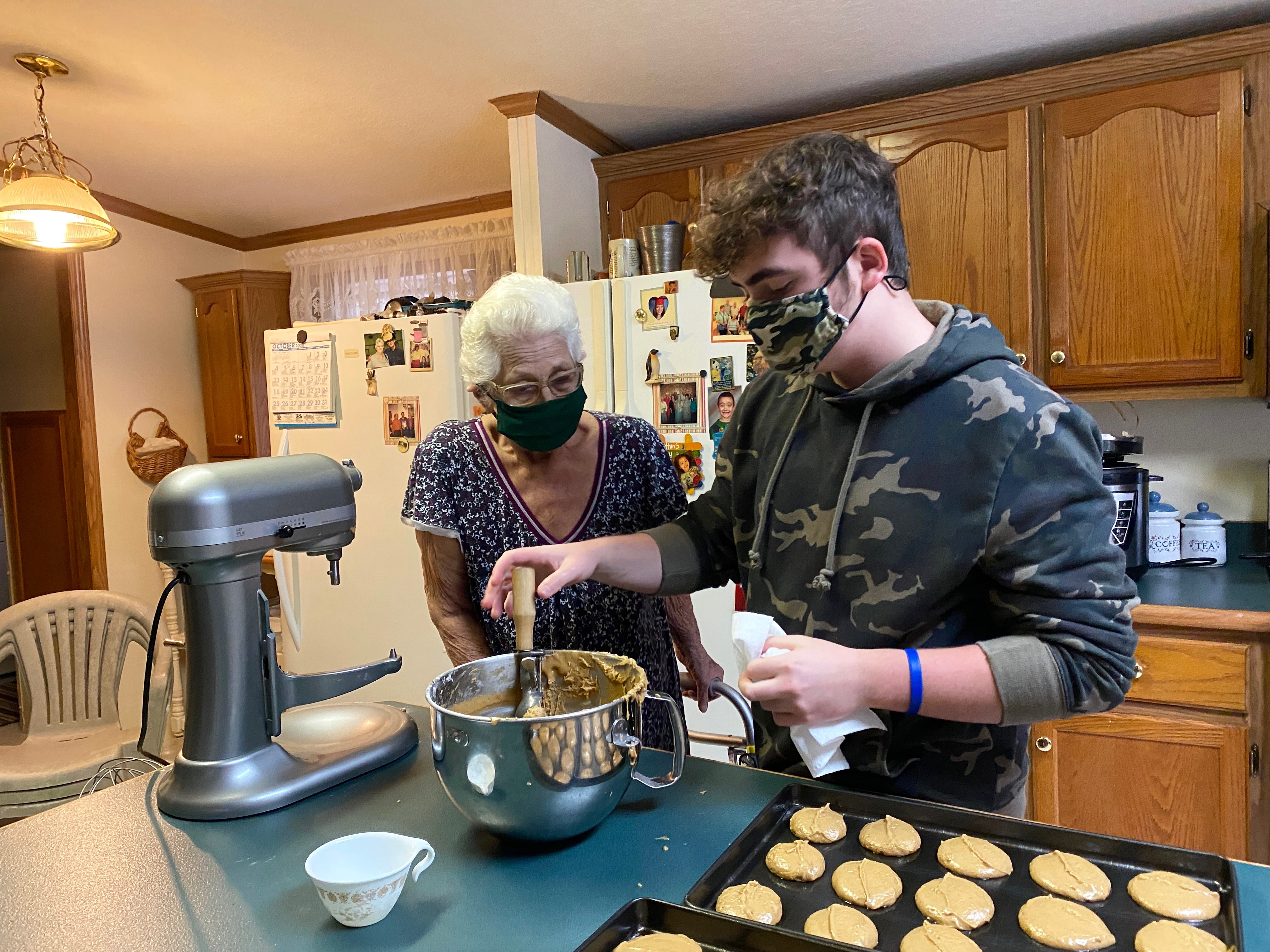 Caption: LaRue Laferty (left) watches her grandson, Jaxon Conley, portion gingerbread batter onto a metal baking sheet in the kitchen of her Knott County home. Growing up in neighboring Floyd County, Laferty's mother used to make gingerbread for candidates during , Credit: Nicole Musgrave, West Virginia Public Broadcasting