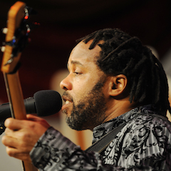 Caption: Victor Wooten on the WoodSongs Stage.