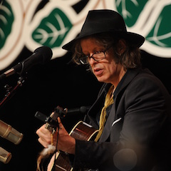 Caption: Mike Scott of The Waterboys on the WoodSongs Stage.