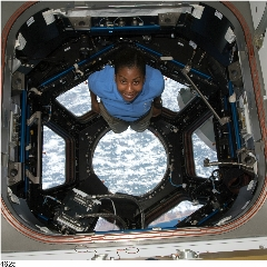 Caption: NASA astronaut Stephanie Wilson in the International Space Station cupola during one of her space shuttle missions., Credit: NASA