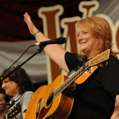 Caption: Emily Saliers on the WoodSongs Stage.