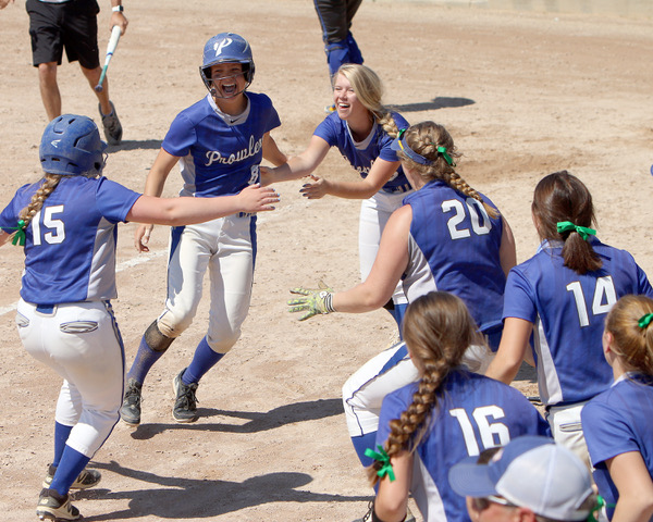 Caption: Joyous softball players from Lincoln H.S. in Thief River Falls, MN