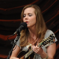 Caption: Sierra Hull on the WoodSongs Stage.