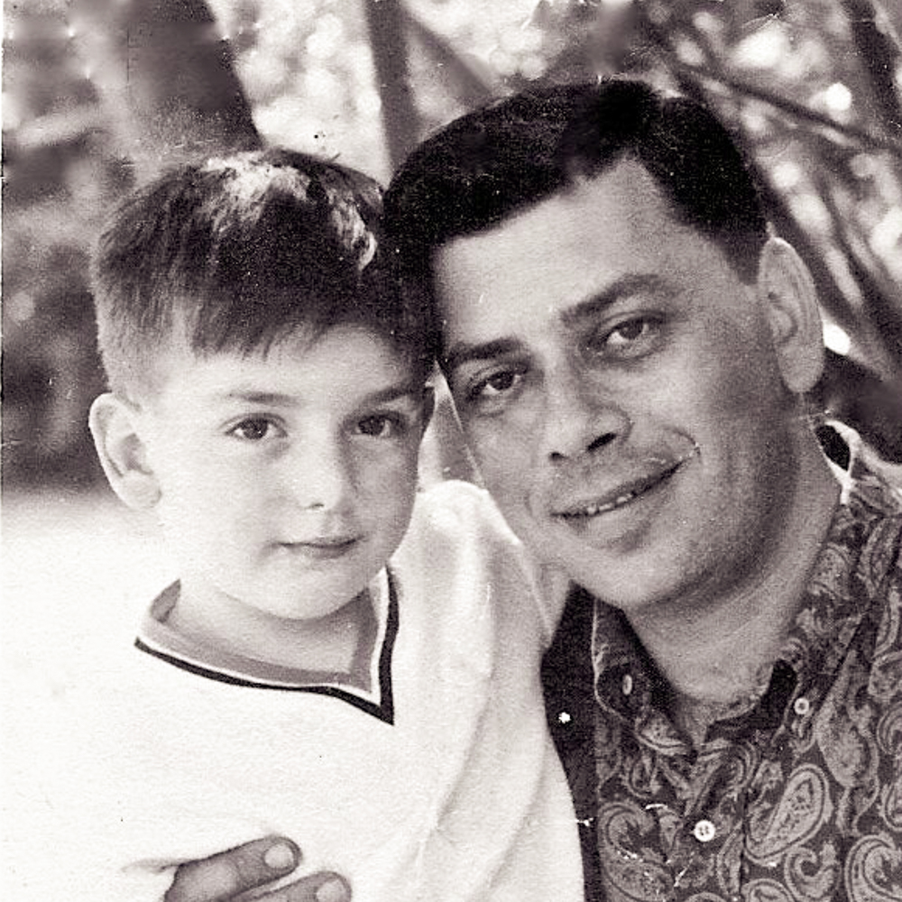 Caption:  A 5-year-old Jeffrey Sherman is pictured with his father, songwriter Robert Sherman, in the early 1960s., Credit: Courtesy of Jeffrey Sherman.