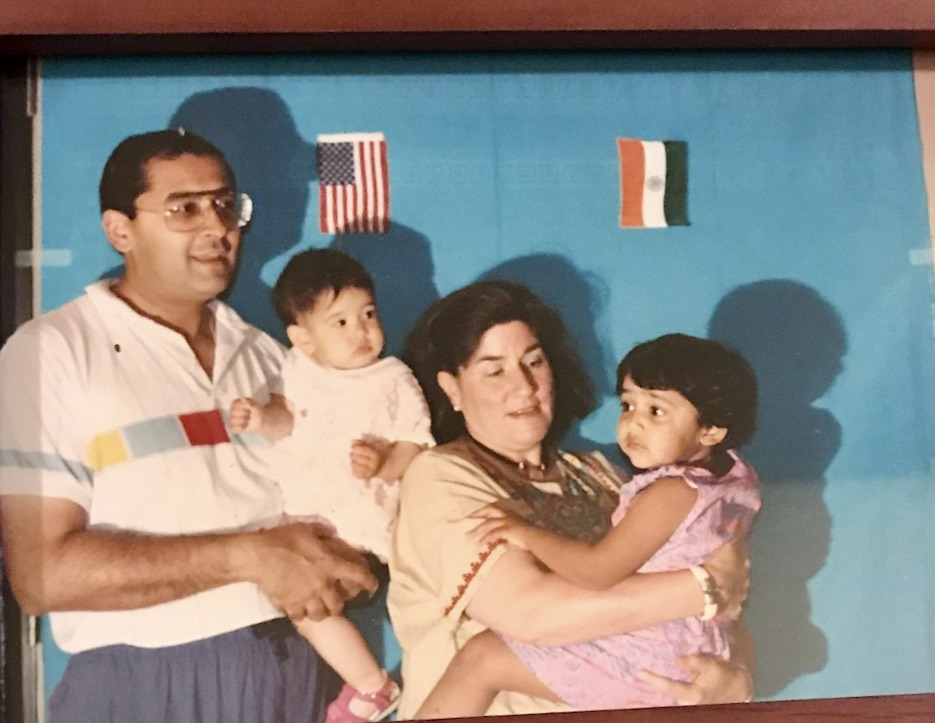 Caption: Shruti Shah (far right) with her father, sister and mother. Shruti's family adopted her from India when she was 11 months old., Credit: Shruti Shah