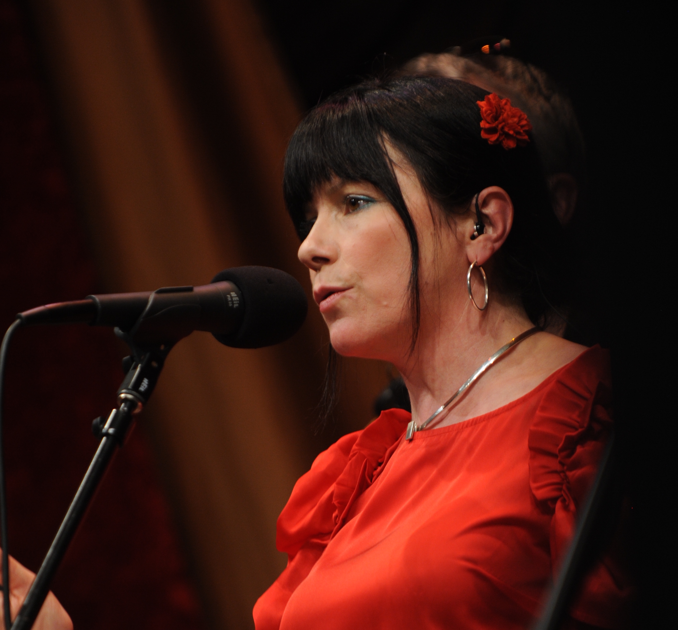 Caption: Cathy Jordan of Dervish on the WoodSongs Stage.