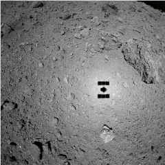 Caption: Hayabusa2 sees its shadow during the second touchdown rehearsal on 15 October 2018. The spacecraft was 47 meters above Ryugu., Credit: JAXA, University of Tokyo, Kochi University, Rikkyo University, Nagoya University, Chiba Institute of Technology, Meiji University, University of Aizu, AIST